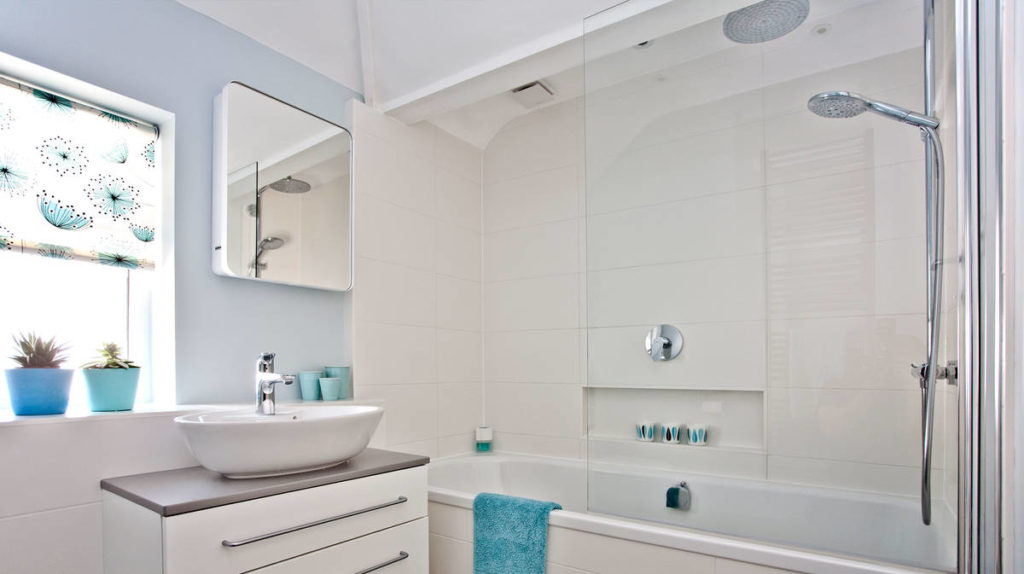 raindance-select-showerpipe_white-blue-bathroom-ambiance_instil_16x9